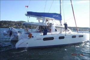 UN catamaran de 36 pieds et une petite pointe au coeur au moment des adieux